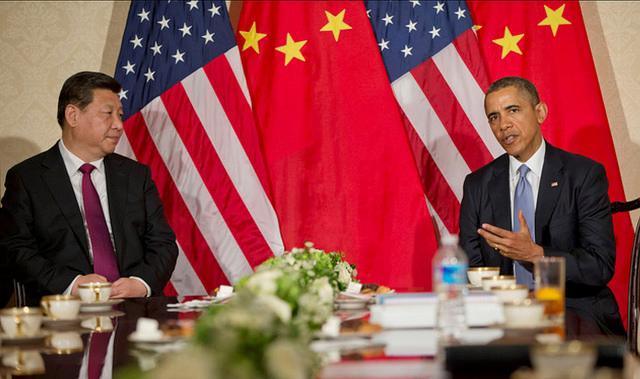 Barrack Obama, le président américain, et Xi Jinping, le président chinois, lors d'un sommet bilatéral  en 2014. (Photo Flickr/U.S. Embassy The Hague)