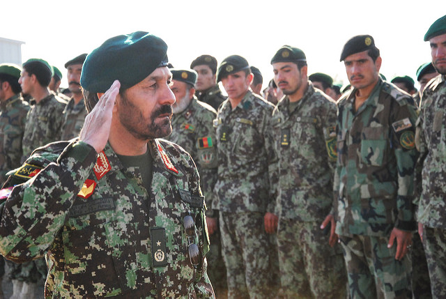 "CAMP HERO, Afghanistan--Afghan National Army Brig. Gen. Abdul Hamid, 205th Hero Corps Commander, salutes his soldiers during a 205th Corps formation Feb. 19 on Camp Hero, Kandahar, Afghanistan.  Established in September 2004, the 205th ""Atul"" is a corps-level organization of the ANA, and it consists of four brigades, a commando battalion and three garrisons. (ANA photo by Sgt. 1st Class Habibullah/Released)"