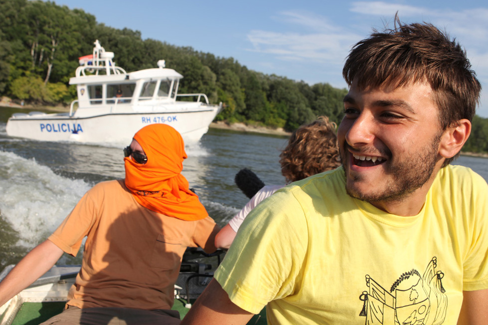Alex Kahn, who has just managed to set foot on Liberty Island - part of Liberland - is happy to have gotten away from the Croatian police boat which was trying to get the boat back into the Croatian waters so the Croatian police can arrest the Liberland boat's occupants.
