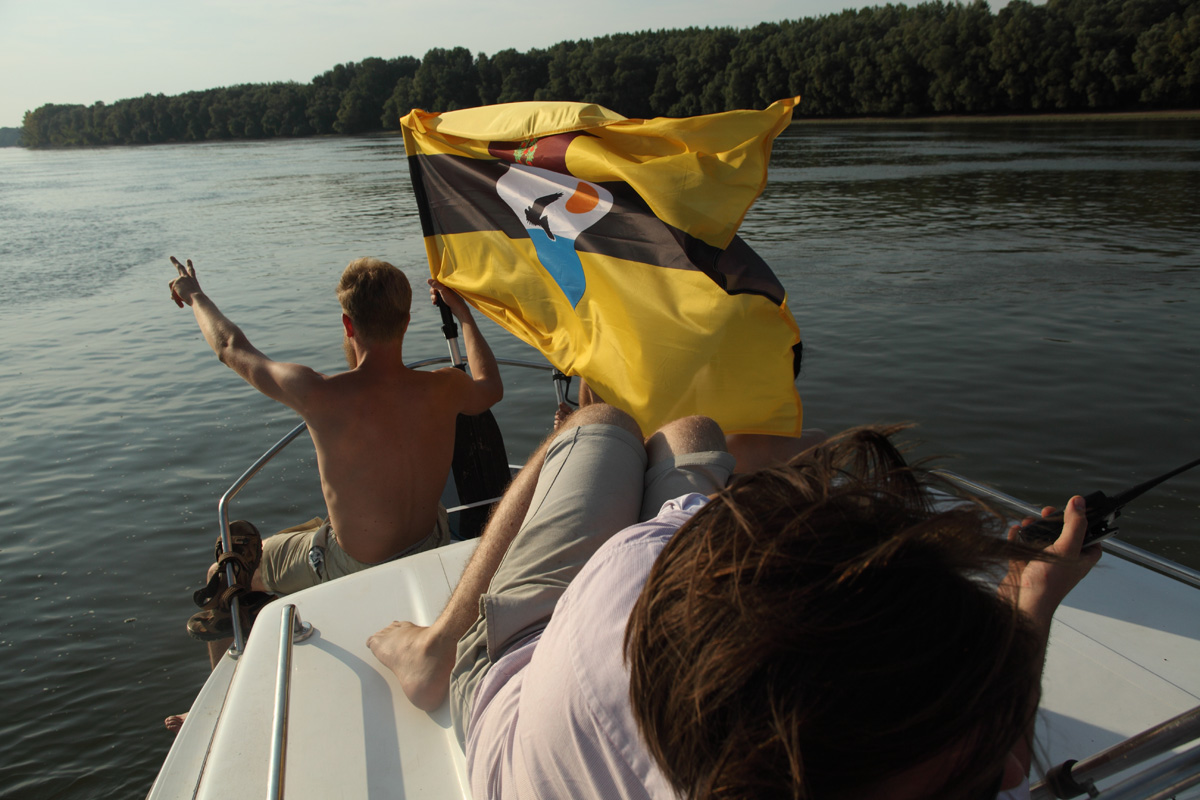 LSA member Yoshi Livo holding the Liberland flag on the Danube